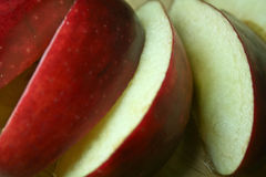 Red Delicious Apple Slices. Slices of a ripe Red Delicious apple on a cutting board Royalty Free Stock Images
