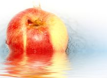 Red delicious apple in water. Stock Photos