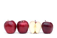Red delicious apples with one sliced apple Royalty Free Stock Photos