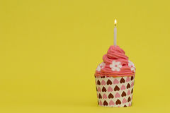 Red delicious birthday cupcake with candle Stock Photography