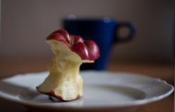 Red delicious Bitten apple on the plate Stock Photo