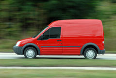 Red delivery car driving Royalty Free Stock Image