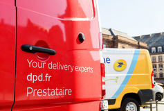 Red delivery postal van with DPD slogan. STRASBOURG; FRANCE - JUN 24; 2016: Your delivery experts DPD parcel text on the red postal van in French city of Stock Photography
