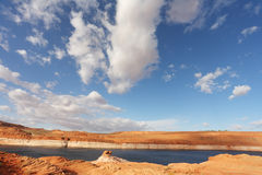 Red desert and the blue water Stock Photo