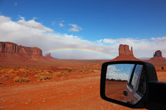 Red Desert it reflected in the car mirror stock photography