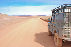 Red Desert Road in SUV Royalty Free Stock Photo
