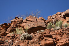 Red Desert Rock Wall under Blue Sky Royalty Free Stock Photography