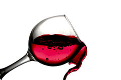 Red desert wine poured in glass on white background Stock Images