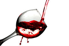 Red desert wine poured in glass on white background Stock Photos