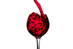 Red desert wine poured in glass on white background Stock Image