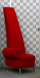 Red designer chair. Close up of bright red designer chair royalty free stock photo