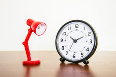 Red desk lamp with alarm clock Royalty Free Stock Image