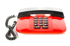 Red desk phone Stock Images