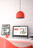 Red desktop with laptop showing express delivery website Royalty Free Stock Photo