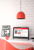 Red desktop with laptop showing secondhand store web Royalty Free Stock Images