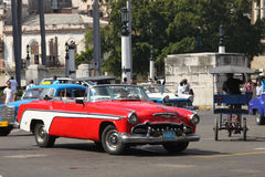 A red Desoto vintage car of 1955. HAVANA, CUBA-FEB 2: A red Desoto car, 1955,  driving in the center of Havana on Feb 2, 2011. Before a new law issued on October Stock Photography