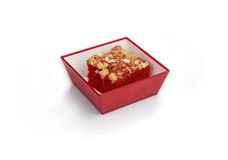 Red dessert, airline food. Pet food, dog, cat treats on a colorful plate Royalty Free Stock Photo