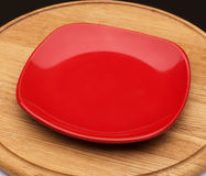 Red dessert plate on a wooden board Royalty Free Stock Photo
