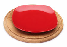Red dessert plate on a wooden board. Stock Photos