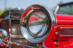 Red detail on the headlight of a vintage car Royalty Free Stock Image