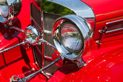 Red detail on the headlight of a vintage car Stock Image