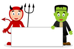 Red Devil & Frankenstein with Blank Banner Stock Photos