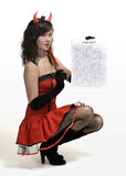 Red devil girl with a contract. Beauty attractive red devil girl with a contract over white Royalty Free Stock Photo