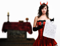 Red devil girl with a contract Stock Photo