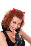 Red devil girl flirting with you. Cute red devil girl flirting with you royalty free stock photography