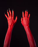 Red devil hands with black nails Royalty Free Stock Images