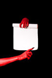 Red devil hands with black nails holding paper scroll Royalty Free Stock Image