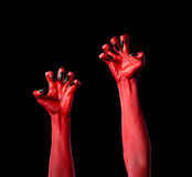 Red devil hands with black nails, real body-art Stock Photo