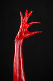 Red Devil's hands with black nails, red hands of Satan, Halloween theme, on a black background, isolated Royalty Free Stock Photos