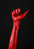 Red Devil's hands with black nails, red hands of Satan, Halloween theme, on a black background, isolated Stock Photography