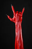 Red Devil's hands with black nails, red hands of Satan, Halloween theme, on a black background, isolated Stock Photo