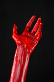Red Devil's hands with black nails, red hands of Satan, Halloween theme, on a black background, isolated Royalty Free Stock Image