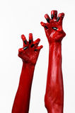 Red Devil's hands with black nails, red hands of Satan, Halloween theme, on a white background, isolated Royalty Free Stock Photography