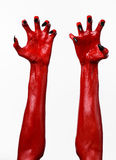 Red Devil's hands with black nails, red hands of Satan, Halloween theme, on a white background, isolated Royalty Free Stock Image