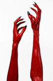 Red Devil's hands with black nails, red hands of Satan, Halloween theme, on a white background, isolated Stock Image