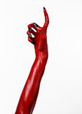 Red Devil's hands with black nails, red hands of Satan, Halloween theme, on a white background, isolated Stock Photography