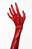 Red Devil's hands with black nails, red hands of Satan, Halloween theme, on a white background, isolated Royalty Free Stock Photos
