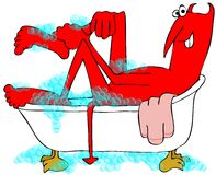 Red devil soaking in a bathtub Royalty Free Stock Photography