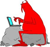 Red devil typing on a laptop computer Royalty Free Stock Photo