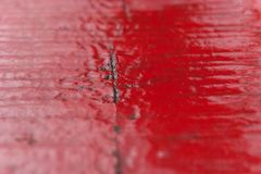 Red dewy wood surface Royalty Free Stock Photo