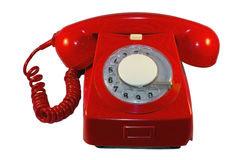 Red dial phone. An old and classic red dial telephone Royalty Free Stock Photos