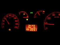 Car dashboard. Red dials in the dark Royalty Free Stock Photo