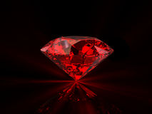 Red diamond on black background Stock Photo