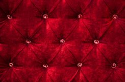Red diamond pattern velvet upholstery background Royalty Free Stock Photos