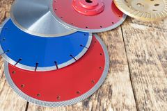 Diamond discs for concrete, reinforced concrete, granite and stone on the background of a wooden old board stock photography