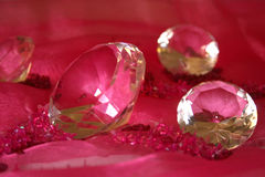 Red diamonds. Diamonds on the pink Royalty Free Stock Photos